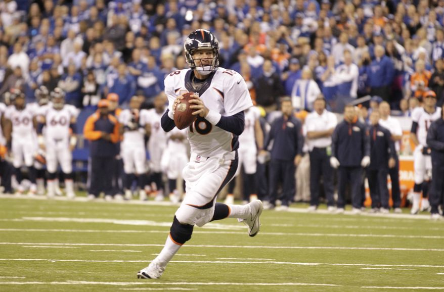 Denver Broncos quarterback Peyton Manning (18) scrambles during the second half of an NFL football game against the Indianapolis Colts, Sunday, Oct. 20, 2013, in Indianapolis. (AP Photo/AJ Mast)