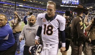 Denver Broncos quarterback Peyton Manning (18) walks off the field after  an NFL football game against the Indianapolis Colts, Sunday, Oct. 20, 2013, in Indianapolis. The Coltsd won 39-33. (AP Photo/Michael Conroy)