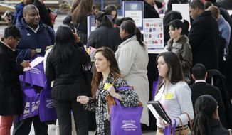 ** FILE ** In this March 14, 2013, file photo, a crowd of job seekers attends a health care job fair in New York. (AP Photo/Mark Lennihan, File)
