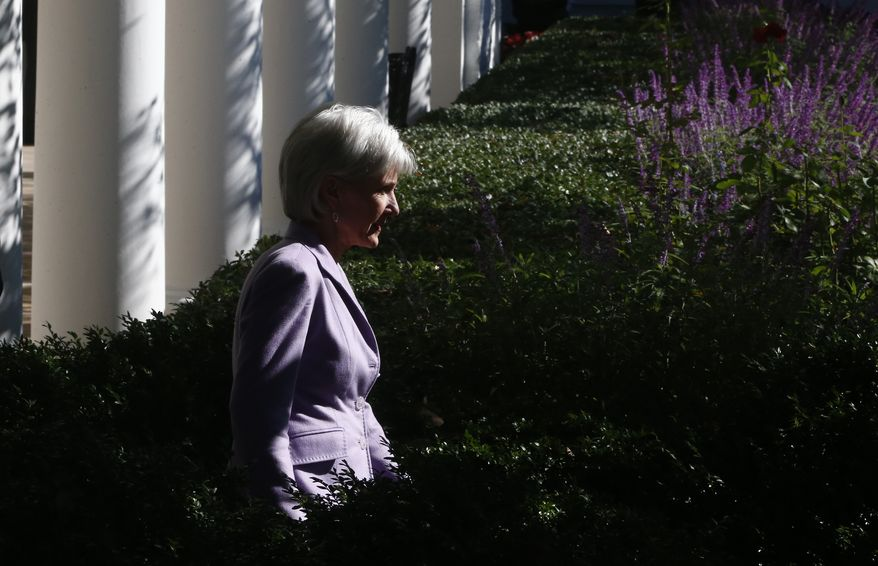 Health and Human Services Secretary Kathleen Sebelius arrives in the Rose Garden of the White House in Washington, Monday, Oct. 21, 2013, before President Barack Obama spoke on the initial rollout of the health care overhaul. Obama acknowledged that the widespread problems with his health care law's rollout are unacceptable, as the administration scrambles to fix the cascade of computer issues. (AP Photo/Charles Dharapak)