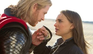 """Chris Hemsworth portrays superhero Thor, and Natalie Portman is Jane Foster in """"Thor: The Dark World."""" Miss Portman said she channeled all her single girlfriends when the script called for her to slap her co-star. The film will be released in the U.S. on Nov. 8. (PARAMOUNT PICTURES-MARVEL STUDIOS VIA ASSOCIATED PRESS)"""