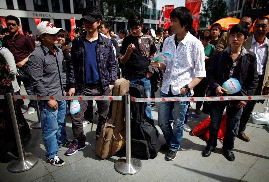 """China has put limits on the popular broadcasts of Chinese reality, dating and talent shows, such as its version of the """"X Factor,"""" where contestants, just like in the U.S., line up for auditions. (Associated Press)"""