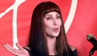 Singer-actress Cher answers questions from the media in Miami, in this Jan. 29, 1999, file photo. (AP Photo/Tony Gutierrez, File) ** FILE **