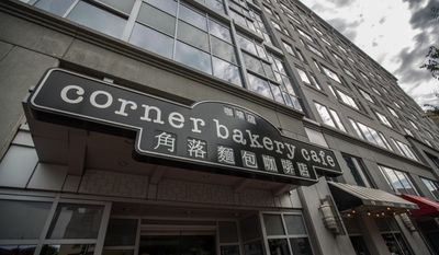 The Corner Bakery Cafe uses Chinese characters on their Chinatown store sign, in Washington, DC., Tuesday, October 21, 2013.  (Andrew S Geraci/The Washington Times)