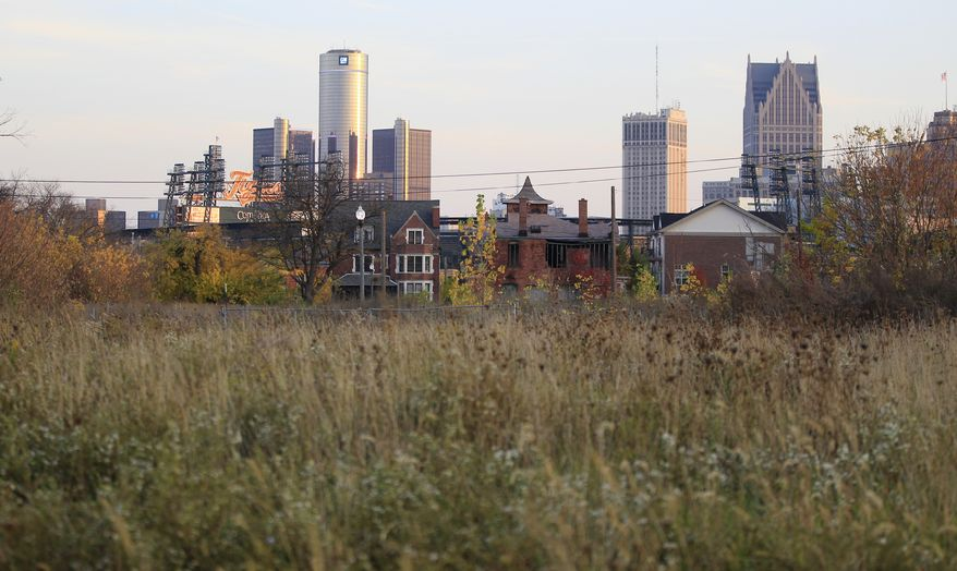 ** FILE ** This Oct. 24, 2012, file photo shows an empty field north of Detroit's downtown. Thousands of Detroit streetlights are dark, many more residents have fled. Donors are replacing ambulances that limped around for 200,000 miles. Detroit's bankruptcy case is going to trial, Wednesday, Oct. 22, 2013, and the result will determine whether the city can reshape itself in the largest public bankruptcy filing in U.S. history. (AP Photo/Carlos Osorio, File)