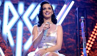 "In this provided by Kitty Purry Inc, Katy Perry performs at her iHeartRadio ""Prism"" album release party at the new iHeartRadio Theatre on Tuesday, Oct. 22, 2013, in Burbank, Calif. (Photo by John Shearer/Invision for Kitty Purry Inc./AP Images)"