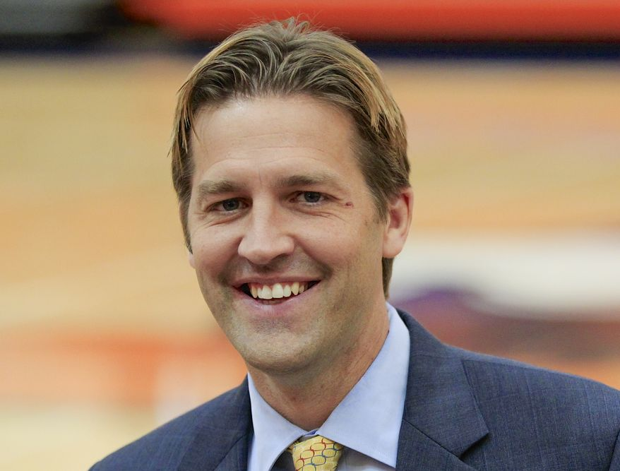 ** FILE ** Midland University President and Republican Senate candidate Ben Sasse is pictured on campus in this photo from June 5, 2013, in Fremont, Neb. (AP Photo/Nati Harnik)