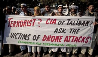 ** FILE ** In this Friday, Dec. 10, 2010, file photo, Pakistani tribal villagers hold a rally to condemn the U.S. drone attacks on their villages in border areas along the Afghanistan border, in Islamabad, Pakistan. Amnesty International calls on the U.S. to investigate reported civilian casualties from CIA drone strikes in Pakistan and compensate victims in a report providing new details about innocent citizens allegedly killed in the attacks. (AP Photo/B.K. Bangash, File)