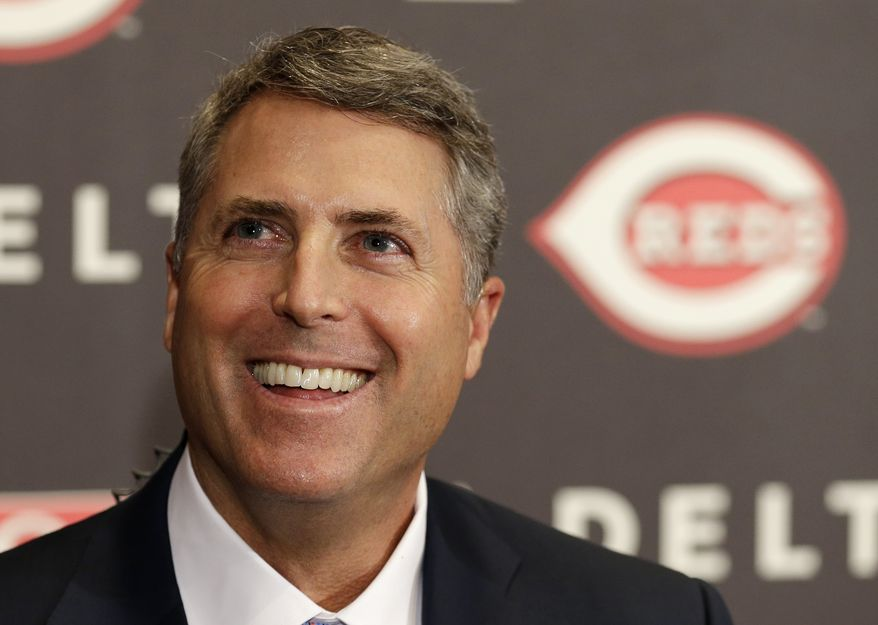 Bryan Price smiles after being named manager of the Cincinnati Reds, Tuesday, Oct. 22, 2013, at a news conference in Cincinnati. Price, who had been the National League baseball team's pitching coach, was signed to a three year contract. Price replaced Dusty Baker. (AP Photo/Al Behrman)