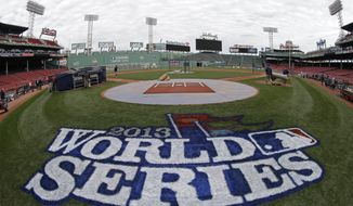 A logo is painted on the field behind home plate at Fenway Park for baseball's World Series Tuesday, Oct. 22, 2013, in Boston. The St. Louis Cardinals face the Boston Red Sox in Game 1 on Wednesday. (AP Photo/David J. Phillip)