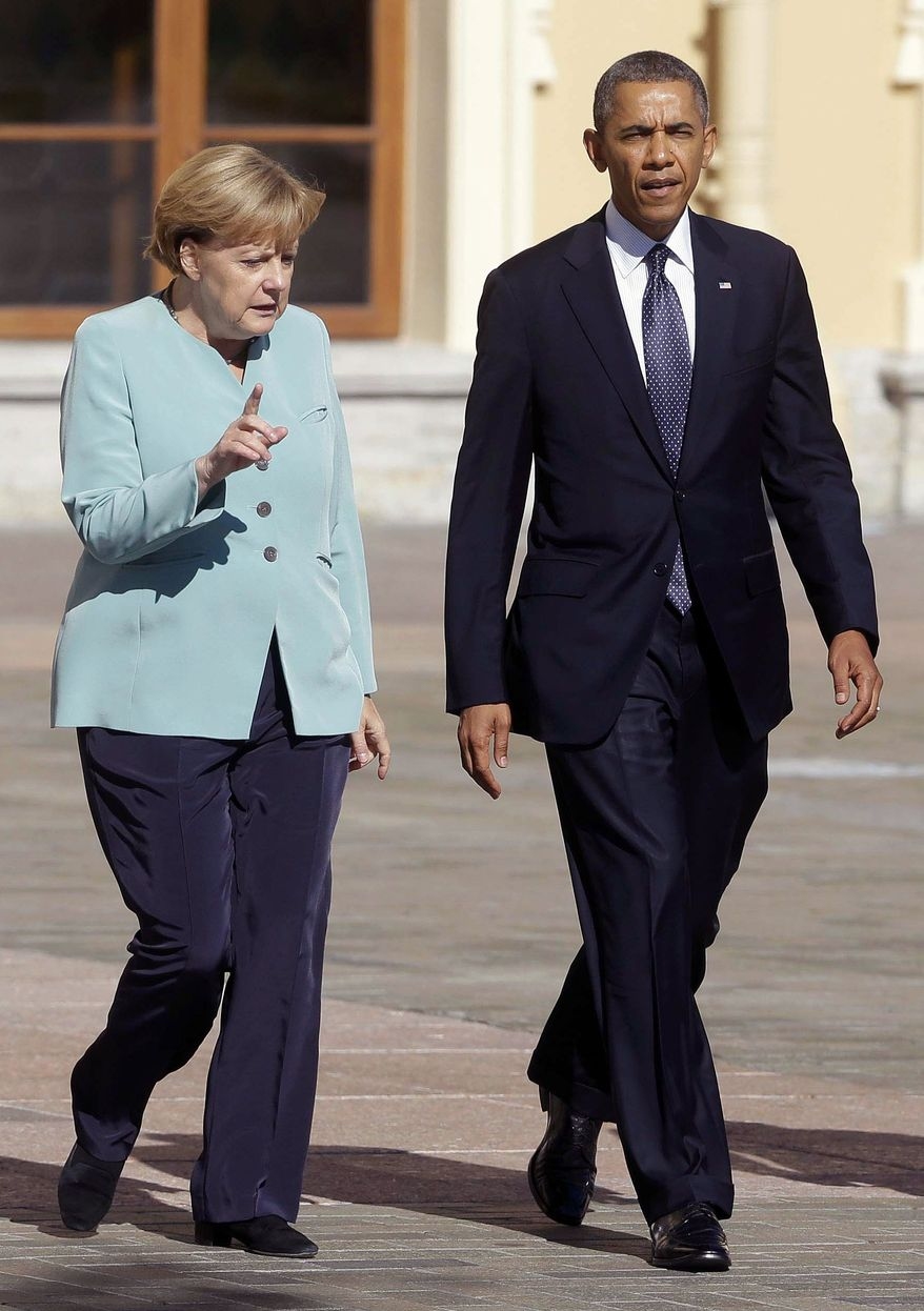 ** FILE ** President Barack Obama walks with German Chancellor Angela Merkel prior to the group photo at the G-20 summit at the Konstantin Palace in St. Petersburg, Russia, Friday, Sept. 6, 2013. (AP Photo/Pablo Martinez Monsivais)