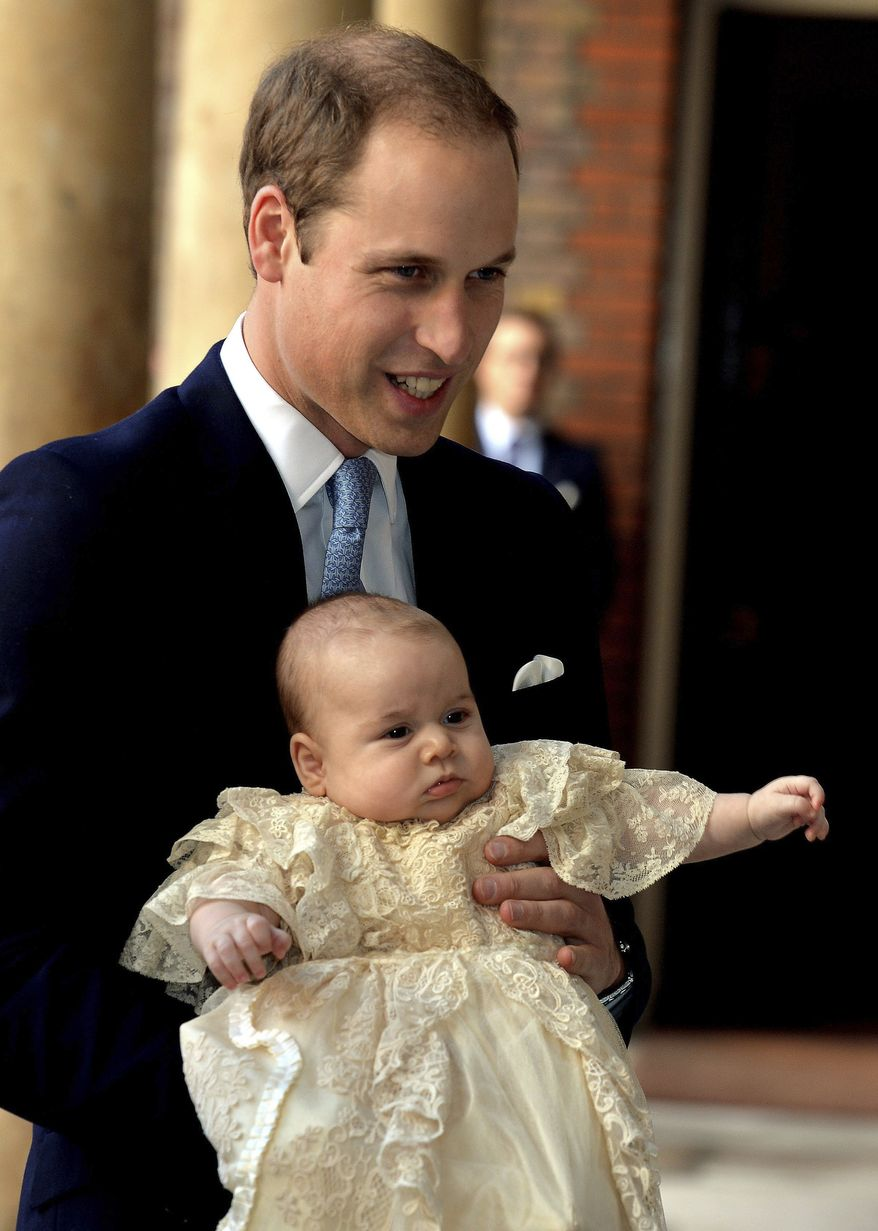 Britain's Prince William, holds his son Prince George as they arrive at Chapel Royal in St James's Palace in London, for the christening of the three month-old Prince Wednesday Oct. 23, 2013.  (AP Photo/John Stillwell/Pool)