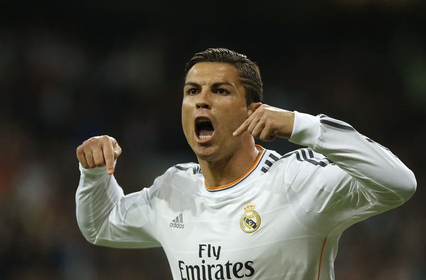 Real's Cristiano Ronaldo celebrates scoring his side's first goal during a Group B Champions League soccer match between Real Madrid and Juventus at the Santiago Bernabeu stadium in Madrid, Spain, Wednesday Oct. 23, 2013. (AP Photo/Andres Kudacki)