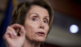 House Minority Leader Nancy Pelosi of Calif. gestures as she speaks to reporters during a news conference on Capitol Hill in Washington, Wednesday, Oct. 23, 2013.   (AP Photo/Manuel Balce Ceneta)