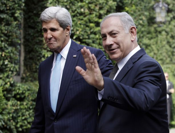 ** FILE ** Israeli Prime Minister Benjamin Netanyahu, right, waves to the media next to U.S. Secretary of State John Kerry on the occasion of their meeting at Villa Taverna, the U.S. Ambassador's residence in Rome, Wednesday, Oct. 23, 2013. Netanyahu and Kerry are expected to talk about Iran's nuclear program and peace negotiations with the Palestinians. (AP Photo/Gregorio Borgia, Pool)