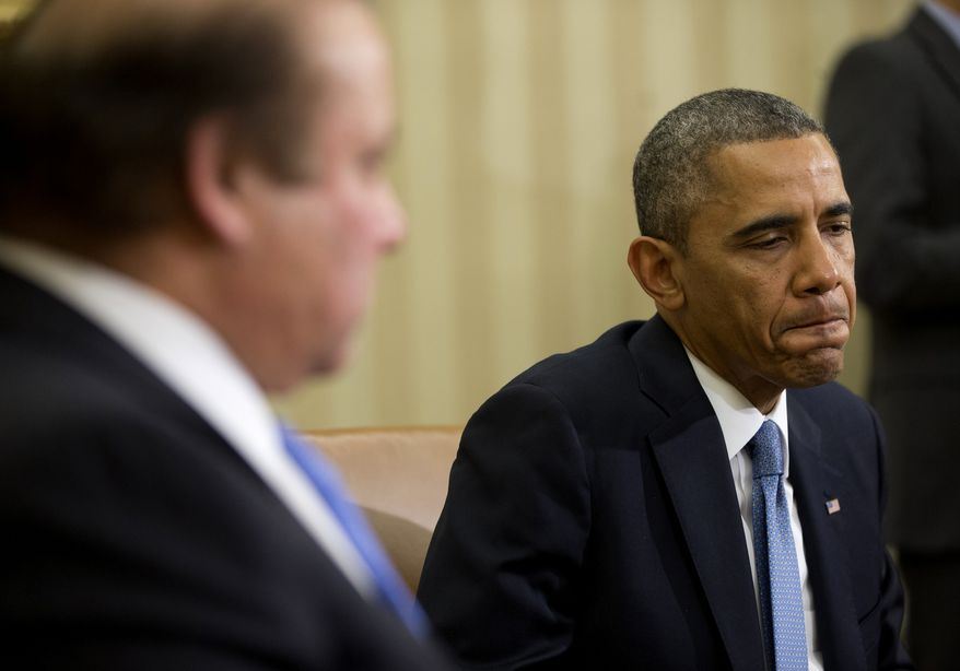 President Barack Obama listens during his meeting with Pakistan Prime Minister Nawaz Sharif in the Oval Office of the White House in Washington, Wednesday, Oct. 23, 2013. In the rocky relationship between the U.S. and Pakistan, the mere fact that Obama and Sharif sit down is seen as a sign of progress. Few breakthroughs are expected on the numerous hot-button issues on their agenda Wednesday, including American drone strikes and Pakistan's alleged support of the Taliban. (AP Photo/Pablo Martinez Monsivais)