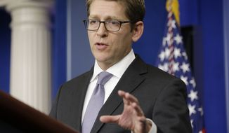White House press secretary Jay Carney gestures during his daily news briefing at the White House in Washington on Wednesday, Oct. 23, 2013. (AP Photo/Pablo Martinez Monsivais)