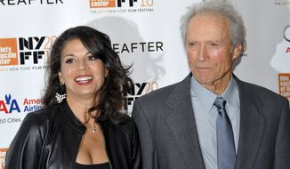 """Actor-director Clint Eastwood and his wife, Dina, attend the premiere of """"Hereafter"""" at Alice Tully Hall in New York during the 48th New York Film Festival in 2010. Mrs. Eastwood, citing irreconcilable differences, filed for divorce on Tuesday, Oct. 22, 2013, in Monterey, Calif., after 17 years of marriage. (AP Photo/Evan Agostini)"""