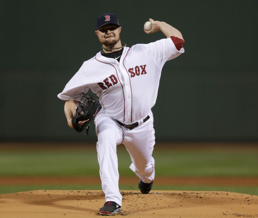 Boston Red Sox starting pitcher Jon Lester throws during the first inning of Game 1 of baseball's World Series against the St. Louis Cardinals Wednesday, Oct. 23, 2013, in Boston. (AP Photo/Charles Krupa)