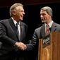 Terry McAuliffe (left) makes nice with rival Kenneth T. Cuccinelli II after their final governor's debate Thursday at Virginia Tech. (associated press)