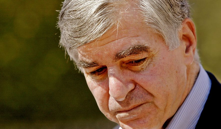 "**FILE** Former Democratic presidential nominee Massachusetts Gov., Michael Dukakis turns away from the podium after speaking at a ""Fair Districts Initiative Petition"" news conference at the foot of the Statehouse steps in Boston Monday, Oct. 3, 2005. (AP Photo/Stephan Savoia)"