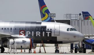 **FILE** A Spirit Airlines airplane sits on the tarmac at Fort Lauderdale-Hollywood International Airport in Fort Lauderdale, Fla., on June 13, 2010. (Associated Press)