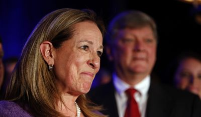 First Congressional District Democratic candidate Elizabeth Colbert Busch gives her concession speech at the Charleston Renaissance Hotel after losing to Republican Mark Sanford, Tuesday, May 7, 2013, in Charleston S.C.  In back is her husband Claus Busch. The two were running in a special election for the state's vacant 1st District congressional seat. (AP Photo/Mic Smith)