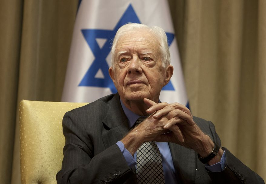 Former U.S. President Jimmy Carter, sits prior to a meeting with Israel's President Shimon Peres at the President's residence in Jerusalem, Sunday, Oct. 21, 2012. Peres met two of 'The Elders', a group composed of eminent global leaders brought together by Nelson Mandela. (AP Photo/Sebastian Scheiner)