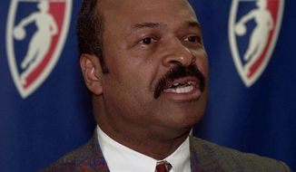 **FILE** Jim Lewis speaks to the media during a press conference Monday, Dec. 29,1997, in Washington. Lewis was named coach of the Washington Mystics, a new franchise in the WNBA. Lewis resigned as head coach of the women's team at George Mason University in Fairfax, Va. to take the position. (AP Photo/Joe Marquette)