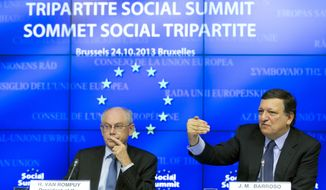 European Union Council President Herman Van Rompuy, left, and European Union Commission President Jose Manuel Barroso participate in a media conference during an EU summit in Brussels on Thursday, Oct. 24, 2013. The two-day summit meeting of EU leaders is likely to be diverted from its official agenda, economic recovery and migration, after German Chancellor Angela Merkel complained to U.S. President Barack Obama that U.S. intelligence may have monitored her mobile phone. (AP Photo/Virginia Mayo)