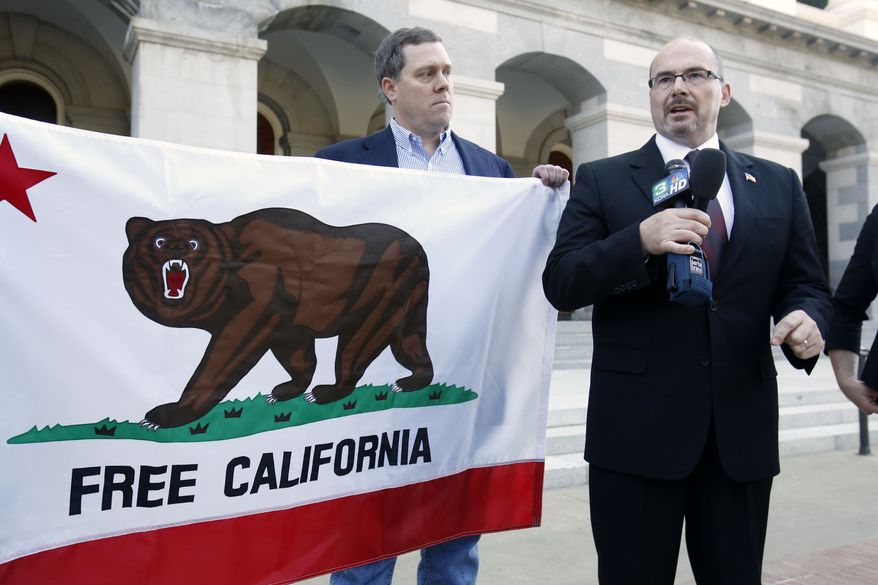 Assemblyman Tim Donnelly, R-Twin Peaks, right, flanked by Tim Knight, who led the recall movement in Colorado against two state legislators for the votes on gun control laws,  announced that they are considering a recall campaign against five Democratic state lawmakers for their support of gun control bills in California, during a news conference in Sacramento, Calif., Thursday, Oct. 24, 2013. (AP Photo/Rich Pedroncelli)