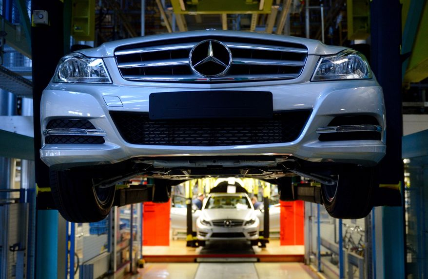 Mercedes Benz C-class cars move down the assembly line at the Mercedes plant in Sindelfingen, Germany, on  Tuesday, Feb 5, 2013. (AP Photo/dpa, Bernd Weissbrod)