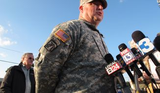 Maj. Gen. Max Haston, right, Adjutant General of the Tennessee National Guard, speaks at a news conference near a Guard armory where two Guard members were shot on Thursday, Oct. 24, 2013, in Millington, Tenn. At left is Tennessee National Guard spokesman Randy Harris. (AP Photo/Adrian Sainz)