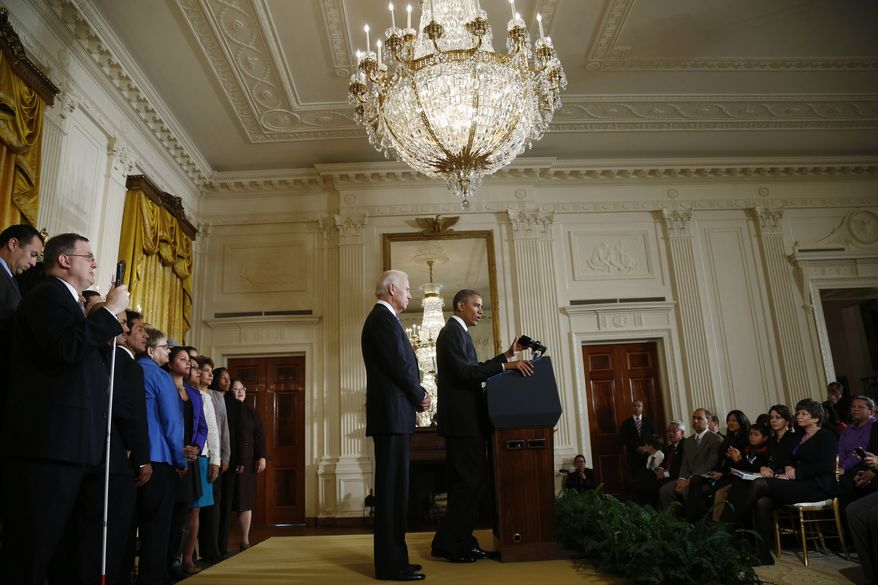 """Vice President Joe Biden stands with President Barack Obama while speaking about immigration Reform, Thursday, Oct. 24, 2013, in the East Room of the White House in Washington. Obama said with the partial government shutdown over, Republicans and Democrats should be able to work together to fix what he called """"a broken immigration system."""" (AP Photo/Charles Dharapak)"""