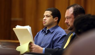 Eric Rivera, left, on trial for the slaying of Washington Redskins star safety Sean Taylor, watches the proceedings in court in Miami, Thursday, Oct. 24, 2013. Rivera admitted to breaking into the NFL player's home, kicking down the bedroom door and shooting Taylor, and drew a detailed diagram of the house, labeling himself as the shooter, a Miami-Dade police detective testified Thursday.  (AP Photo/Miami Herald, Pool) NO SALES