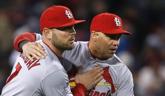 St. Louis Cardinals' Matt Holliday, left, and Carlos Beltran celebrate after Game 2 of baseball's World Series against the Boston Red Sox Thursday, Oct. 24, 2013, in Boston. The Cardinals won 4-2 to tie the series at 1-1. (AP Photo/Elise Amendola)