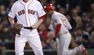 Boston Red Sox relief patcher Craig Breslow reacts after walking St. Louis Cardinals' Daniel Descalso, right, during the seventh inning of Game 2 of baseball's World Series Thursday, Oct. 24, 2013, in Boston. (AP Photo/Elise Amendola)