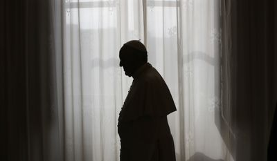 Pope Francis is silhouetted as he leaves after his private audience with Teodoro Obiang Nguema Mbasogo, the President of Equatorial Guinea, at the Vatican, Friday, Oct. 25,  2013. (AP Photo/Max Rossi, Pool)