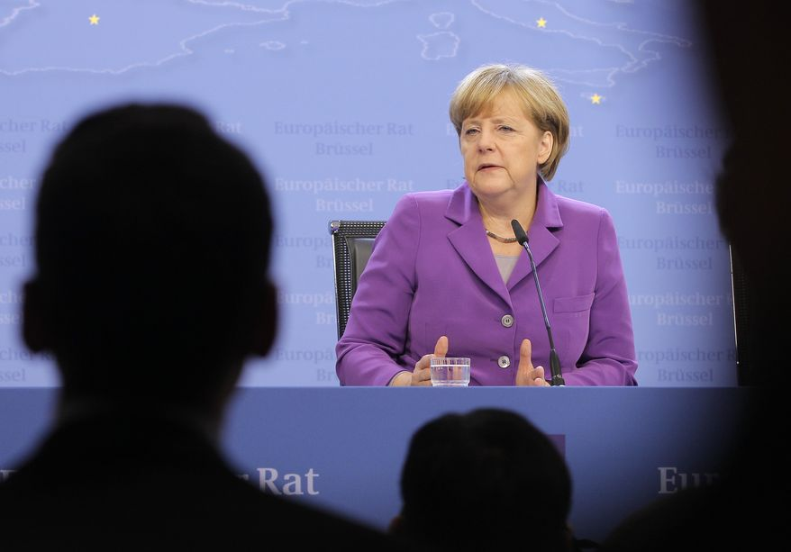 German Chancellor Angela Merkel addresses the media at the end of a two-day EU summit at the European Council building in Brussels, Friday, Oct. 25, 2013. Migration, as well as an upcoming Eastern Partnership summit, topped the agenda in Friday's meeting of EU leaders. (AP Photo/Yves Logghe)