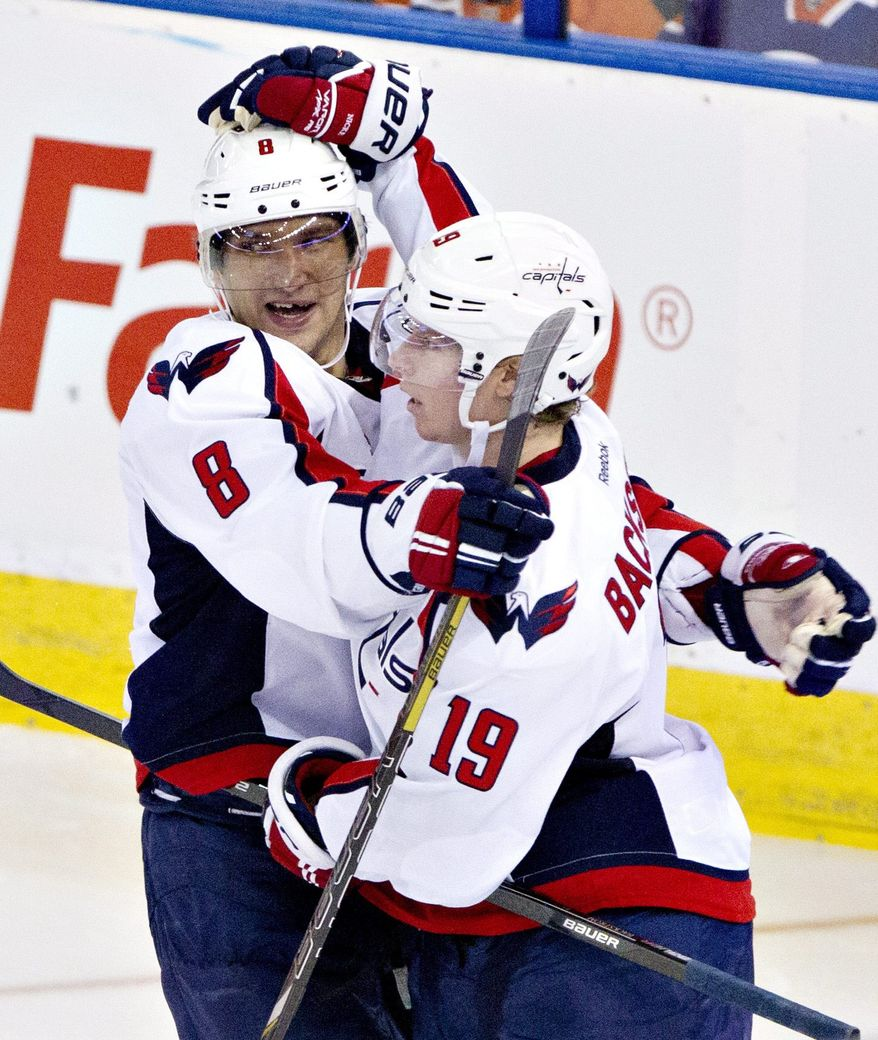 Washington Capitals' Alex Ovechkin (8) and Nicklas Backstrom (19) celebrate a goal against the Edmonton Oilers during third period NHL hockey action in Edmonton, Alta., on Thursday Oct. 24, 2013. (AP Photo/The Canadian Press, Jason Franson)