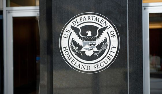 The U.S. Department of Homeland Security seal is shown here in an undated file photo. (Associated Press) ** FILE **