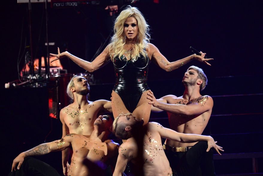 ** FILE ** Ke$ha performs at the IHeartRadio Music Festival in Las Vegas on Sunday, Sept. 22, 2013. Authorities in Muslim-majority Malaysia banned a planned concert by the American pop singer after deciding it would hurt cultural and religious sensitivities. (Al Powers/Powers Imagery/Invision/AP)