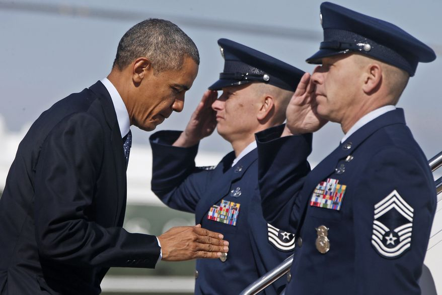 President Barack Obama returns a salute as he boards Air Force One at Andrews Air Force Base, Md., Friday, Oct. 25, 2013, as he travels to New York to visit Pathways in Technology Early College High School (P-TECH) in Brooklyn and attend Democratic National Committee fundraising events. (AP Photo/Charles Dharapak)