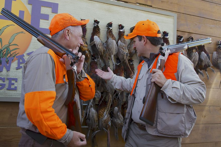 Sen. Ted Cruz, R-Texas, right, talks with Rep. Steve King, R-Iowa, after a pheasant hunt hosted by King on Saturday, Oct. 26, 2013, in Akron, Iowa. Cruz attended the Iowa GOP's annual fundraising dinner in Des Moines, Iowa, on Friday. (AP Photo/Nati Harnik)