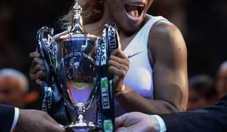 Serena Williams of the USA celebrates as she holds the trophy after her victory over Li Na of China in the final of the WTA Championship in Istanbul, Turkey, Sunday, Oct. 27, 2013. The world's top female tennis players compete in the championships which runs from Oct. 22 until Oct. 27. (AP Photo)
