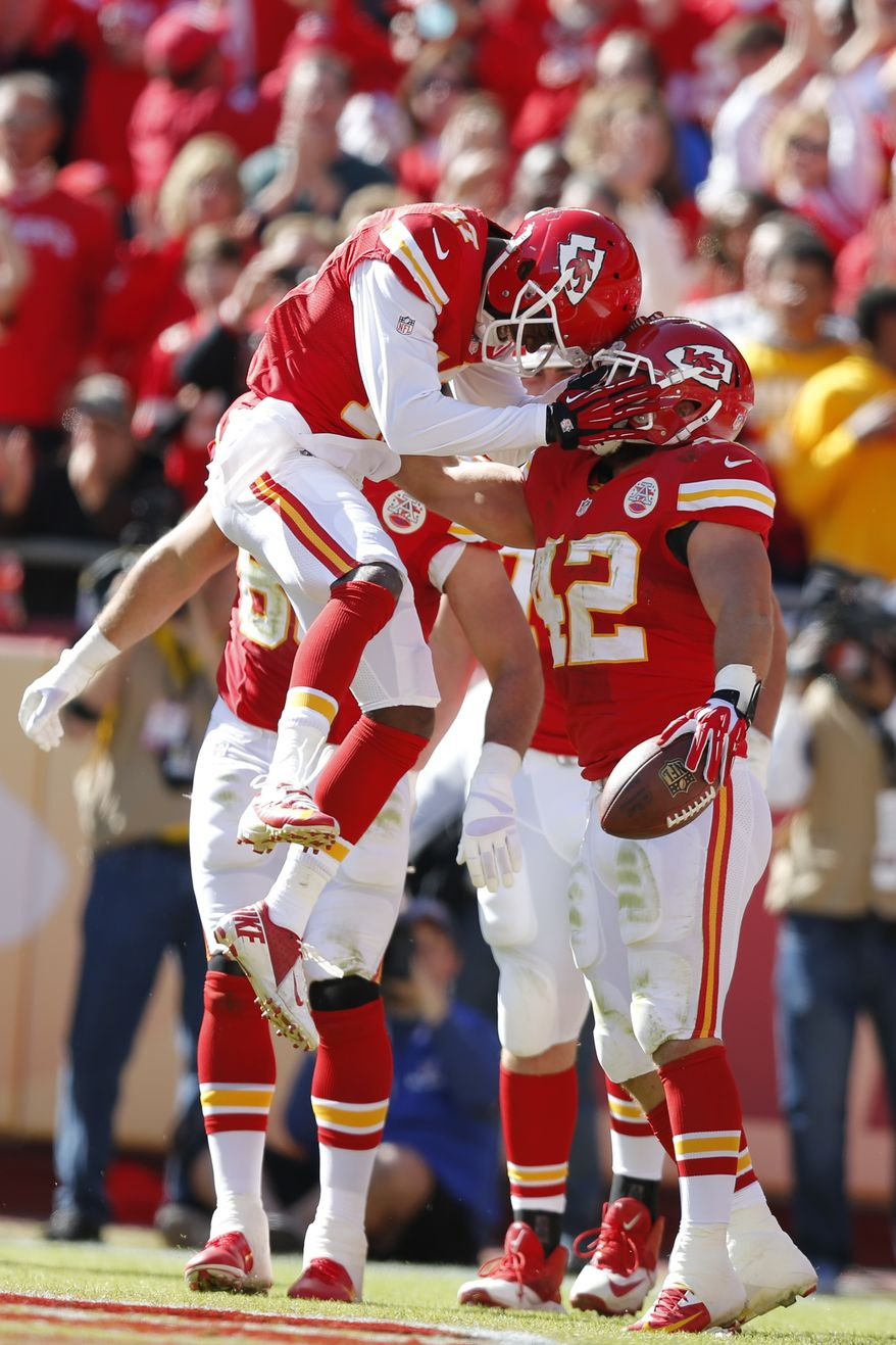 Kansas City Chiefs fullback Anthony Sherman (42) celebrates a touchdown with Kansas City Chiefs wide receiver Donnie Avery (17) during the first half of an NFL football game against the Cleveland Browns at Arrowhead Stadium in Kansas City, Mo., Sunday, Oct. 27, 2013. (AP Photo/Ed Zurga)