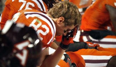 Virginia Tech wide receiver Willie Byrn (82) and his teammates sit as time runs out and Duke wins 13-10 in Blacksburg, Va., Saturday, Oct. 26, 2013. (AP Photo/The Roanoke Times, Matt Gentry)