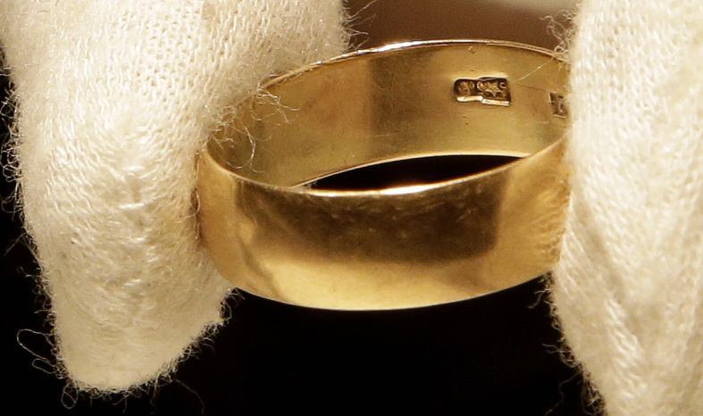 Lee Harvey Oswald's wedding ring, which he left at wife Marina's bedside the morning of the assassination of President John F. Kennedy, sold at auction for $108,000 in Boston on Thursday, Oct. 24, 2013. (AP Photo/Stephan Savoia)