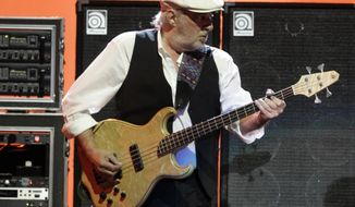 ** FILE ** This March 1, 2009, file photo shows Fleetwood Mac bass player John McVie performing on tour in Pittsburgh, Pa. Fleetwood Mac is canceling planned performances in Australia and New Zealand as McVie is treated for cancer. (AP Photo/Keith Srakocic, file)