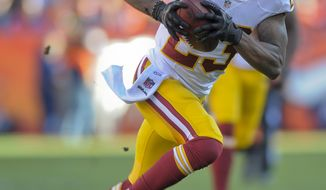 Washington Redskins cornerback DeAngelo Hall (23) runs back an interception fora touchdown against the Denver Broncos in the third quarter of an NFL football game, Sunday, Oct. 27, 2013, in Denver. (AP Photo/Jack Dempsey)